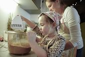 picture of cake-mixer  - Mother and daughter spending quality time together in the kitchen preparing dough for homemade christmas cake - JPG