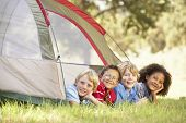 stock photo of tent  - Group Of Boys Having Fun In Tent In Countryside - JPG