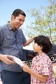 picture of mailbox  - Hispanic Father And Son Checking Mailbox - JPG