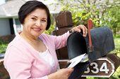picture of mailbox  - Senior Hispanic Woman Checking Mailbox - JPG