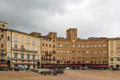 pic of piazza  - Piazza del Campo is the principal public space of the historic center of Siena Tuscany Italy and is regarded as one of Europe - JPG