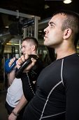 pic of kettlebell  - Kettlebell swing training of two young men in the gym - JPG