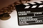 pic of mm  - Movie clapper with 16 mm film - JPG