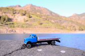 foto of truck-cabin  - Transportation Concept Old Toy Truck on the Rocks - JPG