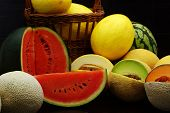picture of muskmelon  - Fresh organic melons on a black background - JPG