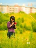 picture of sms  - Woman walking in city park texting using touching cell phone reading sms on smartphone - JPG
