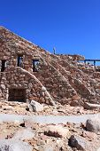 pic of colorado high country  - stone structure located at the summit on mount evans in colorado rocky mountains - JPG