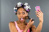 picture of african american hair styles  - An African American woman putting on makeup - JPG