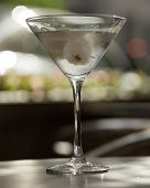 stock photo of vodka  - a glass of cold vodka martini with two lychee  - JPG