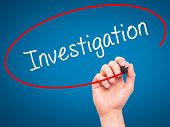 pic of investigation  - Man Hand writing Investigation with marker on transparent wipe board - JPG