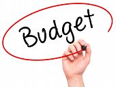 picture of budget  - Man Hand writing Budget with marker on transparent wipe board - JPG