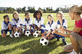 picture of fifties  - Group Of Children In Soccer Team Having Training With Female Coach - JPG