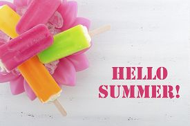 stock photo of gelato  - Summer is Here concept with bright color ice pop ice creams with Hello Summer text - JPG