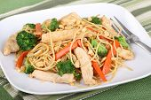 foto of lo mein  - Chicken lo mein with carrots and broccoli on a plate - JPG