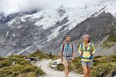 New Zealand backpackers tramping on Mount Cook / Aoraki Hooker valley travel. Backpacking hikers hik poster