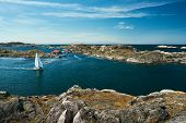 Sea Landscape With Sailboat And Rocky Coastline On The South Of Sweden. Southern Coastline Of Sweden poster