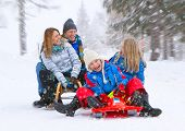 pic of toboggan  - young funny family is sledging in winter - JPG