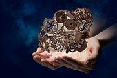 Cogwheel mechanism in hand. Mixed media poster