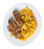 Grilled Pork Ribs With French Fries On A White Plate. Pork Ribs With French Fries On A White Backgro poster