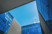 Abstract Architecture Background With Blue Sky And Modern Office Building With Reflection In The Win poster