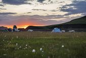 Beautiful Red Purple Sunrise In Landmannalaugar Mountain At Camp Site Area With Grazing Sheep And Te poster