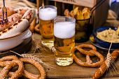 Fresh Craft Beer. German Sausages On The Grill. Traditional German Sausages And Pastry Brezel For A  poster