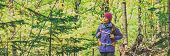 Autumn hike walking woman hiking in forest panoramic banner background. poster