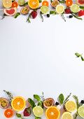Bright flat lay fruit texture background with citruses, herbs and berries top view. Lemon, lime, ora poster