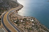 Intersection Of Two Winding Roads And Coastline Of The Sea In The Morning poster