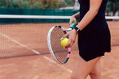 Tennis Player. Close-up Photo Of Athlete Woman In Sportswear Holding Racket And Ball, Playing Tennis poster