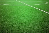 stock photo of football pitch  - football grass background in light and shadow  - JPG