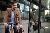 Happy Young Stylish Businessman Going To Work By Bike poster
