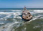 Abandoned And Derelict Old Shipwreck Zeila At The Atlantic Coast Near Swakopmund And Famous Skeleton poster