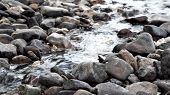 Close Up Of River Stream Flowing Down Over The Grey Stones. Stock Footage. Fast And Cold Brook With  poster
