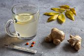 Ginger Tea With Lemon, Ginger Root, Thermometer And Leaves On A Gray Background poster