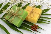 Green And Yellow Handmade Soap Bars On A Green Leaves Over A White Terry Cotton Towel. Natural Toile poster