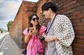 thai couple sightseeing around chiang mai old city wall poster