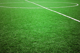 picture of football pitch  - football grass background in light and shadow  - JPG