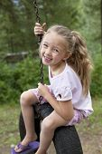 picture of tire swing  - Child swinging on tire - JPG
