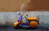 picture of vespa  - Vespa an Italian vintage colorful scooter in Rome - JPG