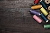threads on brown wooden table background