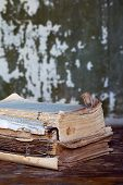 stock photo of annal  - Vintage books on a wooden surface sepia  - JPG