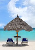 Thatched Hut On A White Sand Beach In Aruba