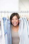 stock photo of peep  - Small business clothing shop owner portrait in store - JPG