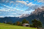 Hut On Meadow And Karwendel Mountain Range By Mittenwald