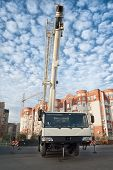 pic of boom-truck  - Mobile crane truck and blue sky at construction background - JPG
