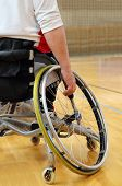 pic of paralympics  - Sportsman in a sport wheelchair in a gym