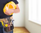 stock photo of blue-collar-worker  - Image of a blue collar worker with tool belt - JPG
