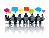 image of bubbles  - Group of Business People at Meeting Table with Speech Bubbles - JPG