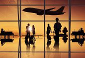 stock photo of air hostess  - Silhouette of Travellers and Pilot at an Airport - JPG